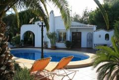 Two bedroom villa with sea views and private swimming pool within prestigious Puerto Blanco, Calpe